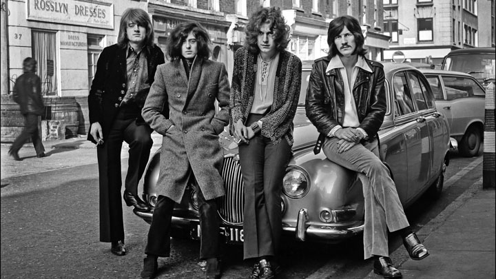 UNITED KINGDOM - DECEMBER 01: Photo of LED ZEPPELIN posed on a Jaguar car in London in December 1968. Left to right: John Paul Jones, Jimmy Page, Robert Plant and John Bonham.(Photo by Dick Barnatt/Redferns)