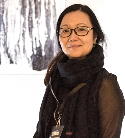 Lisa Liu with her paintings inspired by music